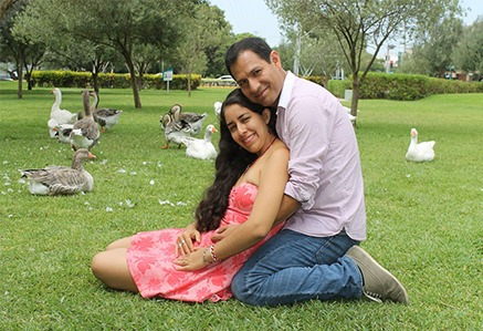 husband holding wife in a park